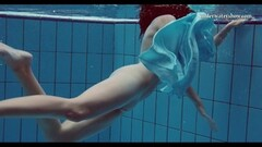 Sexy teen underwater swims and strips Thumb