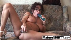 Naughty Grandma with glasses masturbates and sucks cock! Thumb