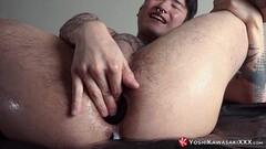 Jap pussy gets a massive vibrator inside Thumb