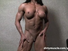 Muscular Brunette Plays With Her Big Clit Thumb