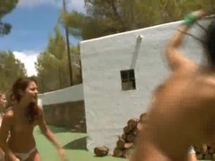 Five naked models getting wet outside Thumb