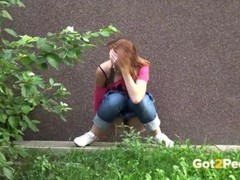 Shy and nervous redhead pees outside Thumb