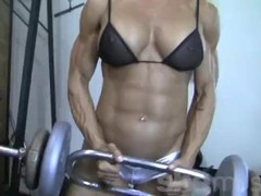 Blonde Female Bodybuilder in See Thru Top Works Out Hard Thumb